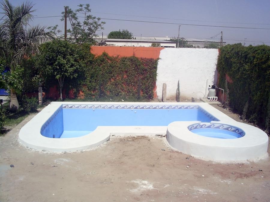 Foto piscina hormigon 6x4 con chapoteadero de regio aqua - Piscina de hormigon ...