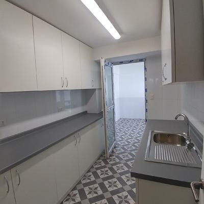 Cocina y Loggia, remodelacion casa las Condes