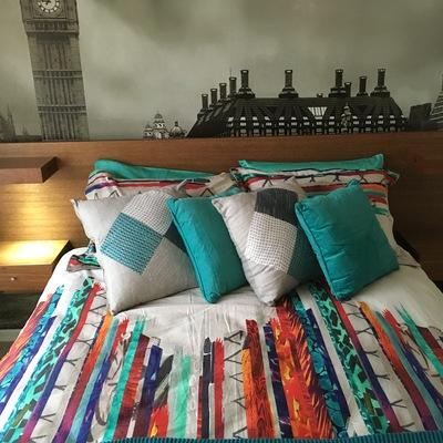 Dormitorio y cama con respaldo a pedido y luz integrada
