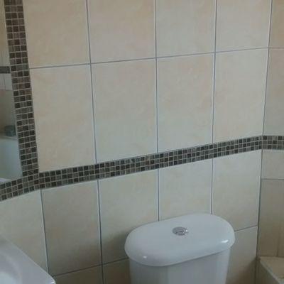 Instalación cerámicos de muro, mosaico y espejo