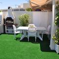 cesped artificial terraza casa de verano