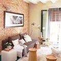 Living con pared de ladrillo visto