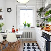 Cocina estilo nórdico con mesa para comer