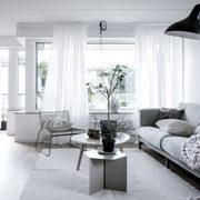 Living blanco en departamento remodelado