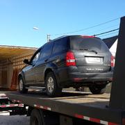 subiendo vehiculo a camion