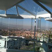 Cierre de balcón y fabricación de techo de vidrio, departamento en Huechuraba
