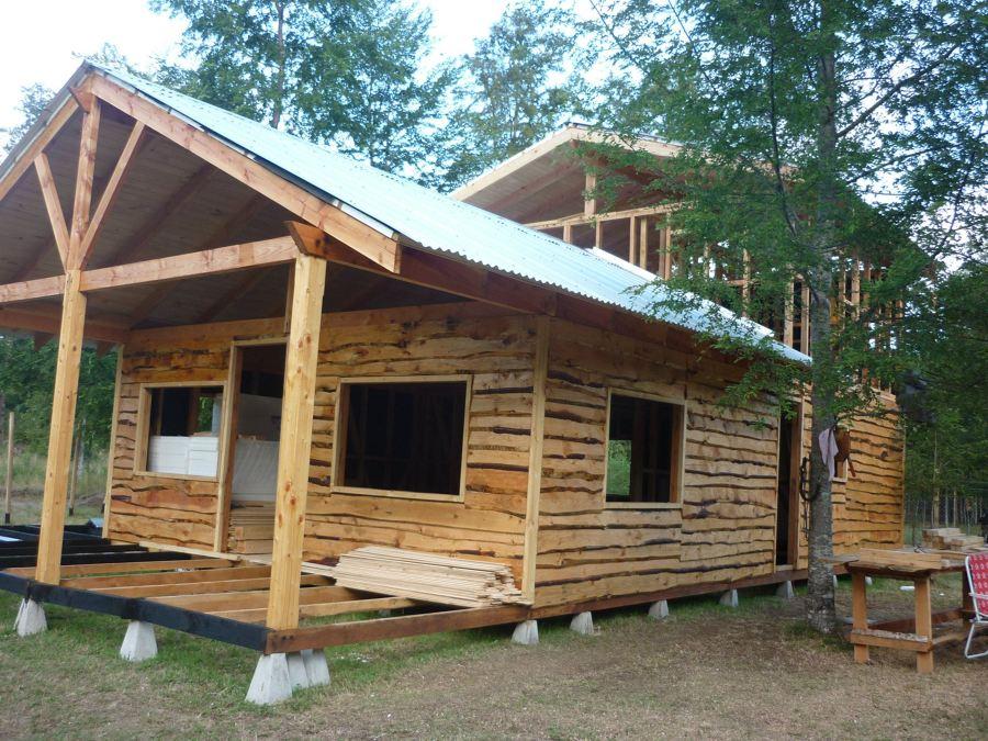 Construcci n de casa en caburgua puc n ideas for Bar de madera de pino