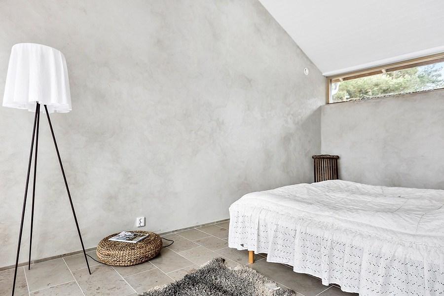 Dormitorio con microcemento