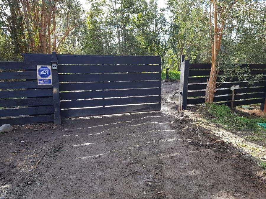 Portón de acceso a vivienda