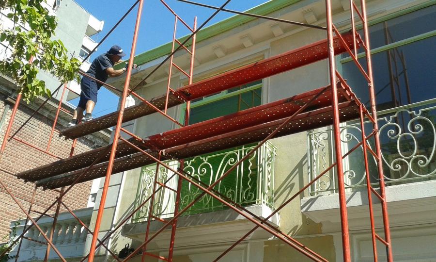 Proceso de pintura de fachada
