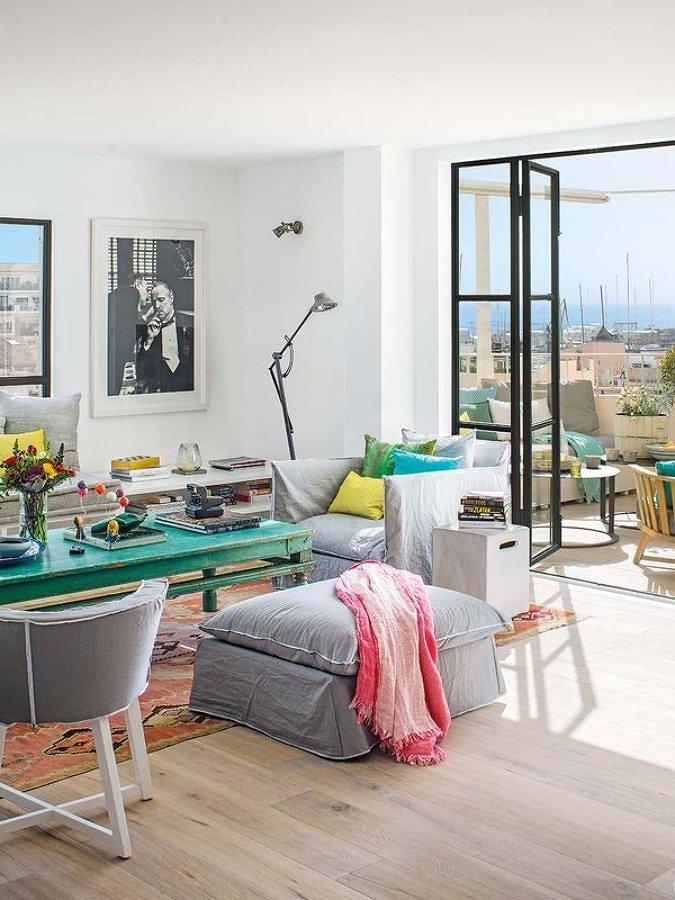 living abierto a terraza