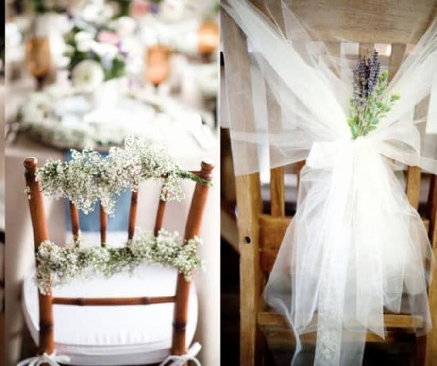 sillas decoradas con flores y tela