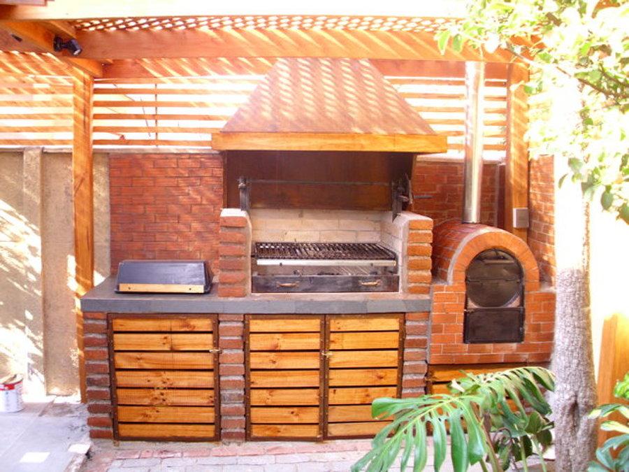 Foto terraza conn quincho de construcciones flopito for Como hacer una terraza rustica