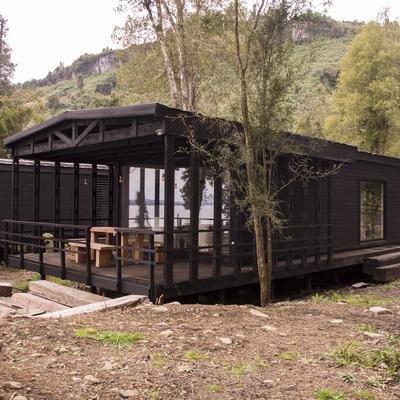 Una cabaña de madera que hace del bosque su santuario