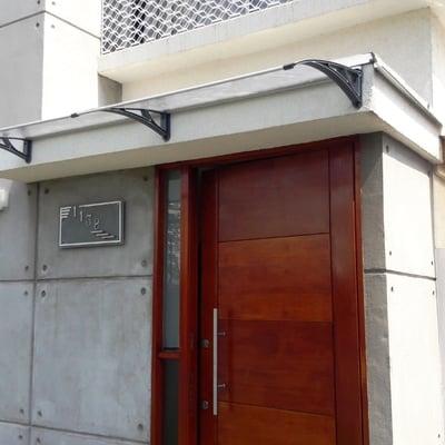 Puerta acceso pivotante Vitacura