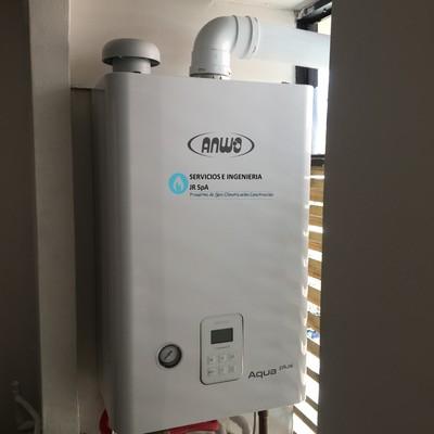 Suministro e instalación sistema de calefacción central vía radiadores.