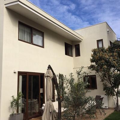 ampliación de vivienda con terrazas y piscina