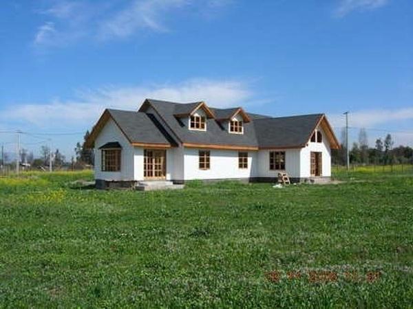 Foto casa campo de madera revestida en ziding de for Casas de campo de madera