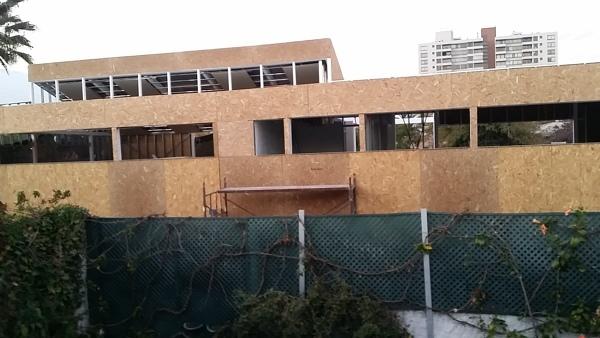 Construcción en casa vecina. ¿Distancia de ventanas?
