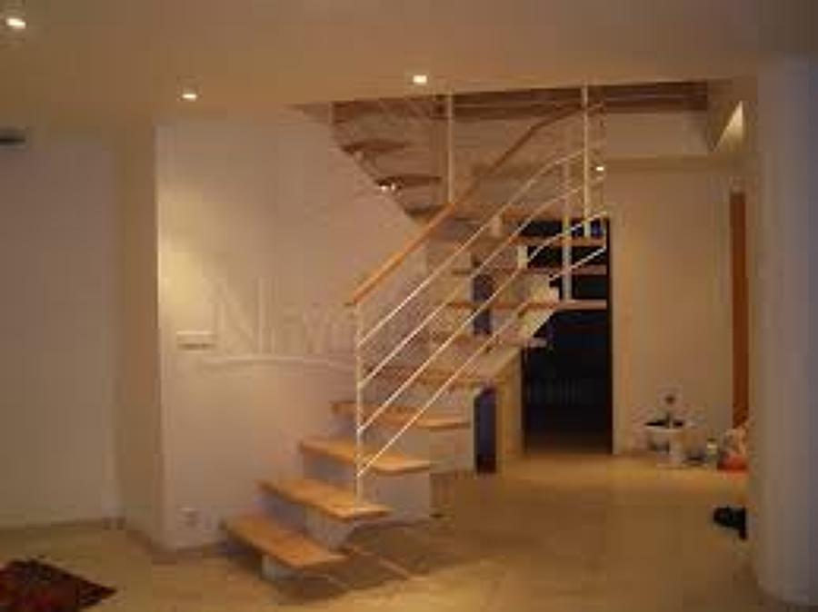Construccion de escalera interior casa maip regi n for Escalera interior casa