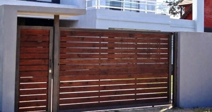 Necesito reja port n con fierro y madera en huechuraba for Casas de chapa para jardin