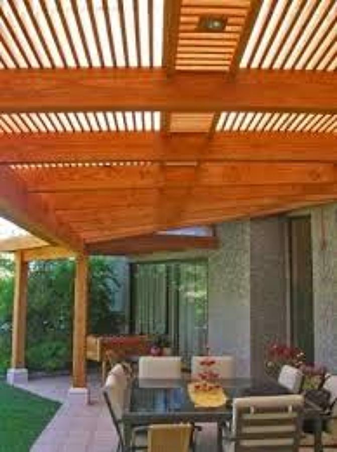 Construcci n de terraza de 580 cm x 400 cm frente a mall for Casas sobre terrazas
