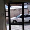 Reparación puerta entrada edificio